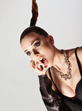 Studio fashion shot: portrait of screaming cute young woman Stock Images