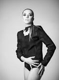 Studio Fashion Shot: Pretty Young Woman Wearing Black Jacket Backwards Stock Photos