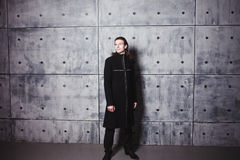 Studio fashion of young handsome man in coat Stock Images