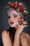 Studio female beauty portrait with rowan Stock Image
