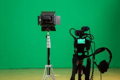 Studio for filming on a green background. The chroma key. Lighting equipment in the Studio. Green screen.  stock images