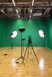 Studio for filming on a green background. The chroma key. Lighting equipment in the Studio. Green screen.  stock image