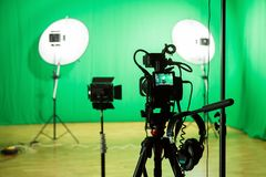 Studio for filming on a green background. The chroma key. Lighting equipment in the Studio. Green screen.  royalty free stock images