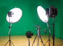 Studio for filming on a green background. The chroma key. Lighting equipment in the Studio. Green screen.  stock photos