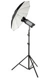 Studio flash with umbrella and stand on white Royalty Free Stock Images