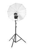 Studio flash with white umbrella and stand on white Stock Photography