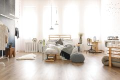 Studio flat with pallet bed Royalty Free Stock Images