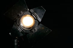 Studio floodlight on black background. With warm tungsten light Royalty Free Stock Photography