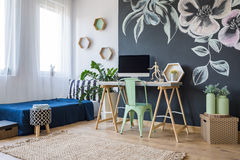 Studio with a floral motif. Modern studio apartment with adorable floral motif royalty free stock images