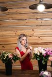 Studio flowers and home decor. Build bouquets for the holidays. A florist girl beautifully collects bouquets for a wedding. A bride`s wedding bouquet royalty free stock photography