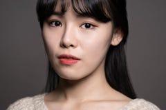 Studio-Frau von 20 traurigen Asiatinnen Lizenzfreies Stockfoto