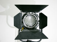 Studio Fresnel Spot Lamp. Film and TV Lamp with barn doors Royalty Free Stock Photography