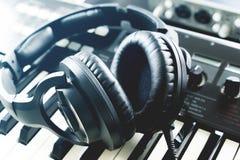 Studio headphone lying on keyboard synthesizer Royalty Free Stock Photo