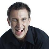 Studio Headshot eines glücklichen Schreiens des jungen Mannes lizenzfreies stockfoto