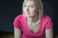Studio headshot portrait of mature woman wearing fuchsia shirt Royalty Free Stock Images