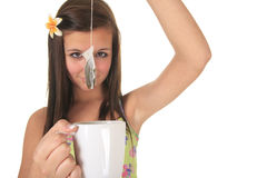Studio image of a beautiful little lady with tea Royalty Free Stock Photo