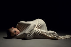 Studio image of mentally ill woman in straitjacket Stock Photo