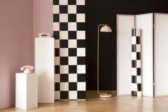 Studio interior with checkerboard wall Stock Photo