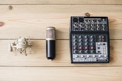 Studio laptop microphone and mixing console on wooden background royalty free stock images