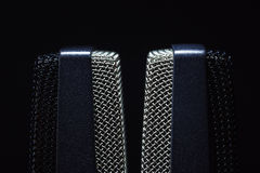 Studio Large Capsule Microphones. Details of two studio microphones, on black background royalty free stock photo