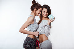 Studio lifestyle portrait of two best friends hipster crazy girls Royalty Free Stock Photos