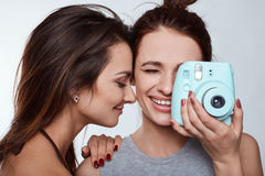 Studio lifestyle portrait of two best friends hipster crazy girls Royalty Free Stock Images