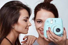 Studio lifestyle portrait of two best friends hipster crazy girls Stock Image