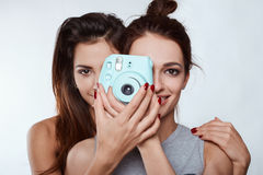 Studio lifestyle portrait of two best friends hipster crazy girls Stock Photography