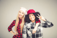 Studio lifestyle portrait of two best friends hipster girls going crazy and having great time together. on stock images