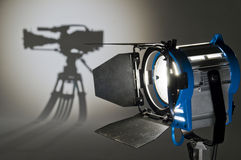 Studio Lighting. Searchlight and silhouette of the chamber Royalty Free Stock Images