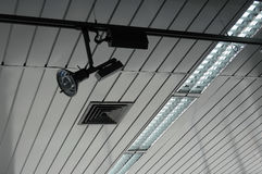Studio lighting ceiling lamps and controlled track spotlight on rail system. Rolling spotlight system and plafond light on the studio ceiling stock photos