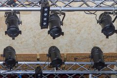 Studio lighting fixtures, lamps in a nightclub. Under the ceiling royalty free stock photos