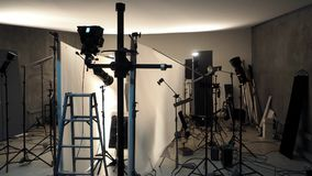 Studio lighting setup for photo shooting production. Studio lighting setup for photo shooting production with many equipment such as softbox, backdrop paper Royalty Free Stock Images