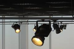 Studio lighting system with follow spotlights at works. Rail system with follow spotlights for stage lightingn stock photo