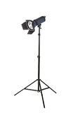 Studio lighting on a tripod stand, isolated on a white background. Professional lighting. Studio spotlight. Photo equipment. Stock Photography