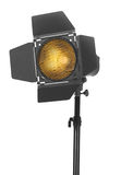 Studio lighting on a tripod stand, isolated on a white background. Spot light photography equipment. Close-up of black studio lighting on a tripod stand stock photo