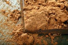 Studio macro cocoa powder and dark chocolate Stock Images