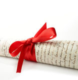 Legal Scroll. Studio macro of legal court papers tied with red ribbon with soft shadows on a white surface. Copy space Stock Images