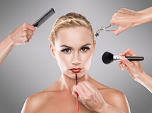 Studio makeup process of a young pretty girl Royalty Free Stock Images