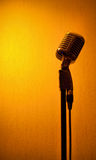 Studio Microphone. A studio microphone on an orange background royalty free stock photography
