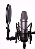 Studio microphone. Studio recording microphone with a pop filter stock photos