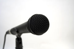 Studio Microphone. Standard recording microphone shot against a neutral white background Stock Image