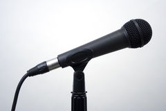 Studio Microphone. Standard recording microphone shot against a neutral white background Stock Photos