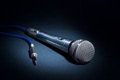 Studio microphone. Low-key of a recording studio microphone Royalty Free Stock Images