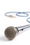 Studio microphone. A recording studio microphone with its cord and plug out of focus royalty free stock photos