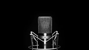 Studio microphone. On a black background in black and white colours royalty free stock photos