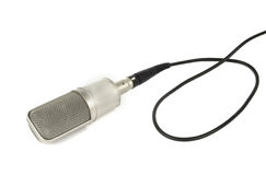 Studio microphone with cable. Isolated over white background Stock Images