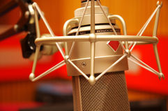 Studio microphone and editing suite. Modern studio microphone Royalty Free Stock Images