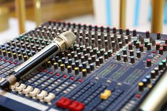 Studio microphone and editing suite. Electronics, communication. Modern studio microphone,Radio studio detail: microphone and mixer Stock Images