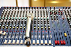Studio microphone and editing suite. Electronics, communication. Modern studio microphone,Radio studio detail: microphone and mixer Stock Photo